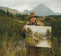 Hamilton Sloan traditional irish artist wearing donegal tweed coat and hat holding a painting of the clady river and mount Errigal standing in front of the clady river and mount Errigal