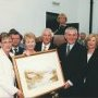Taoiseach Bertie Ahern presented with a hamilton sloan watercolour of the gweedore court hotel the lake and mount errigal by the Doherty family