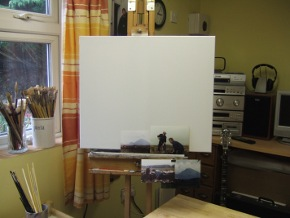 photo of studio showing canvas subject matter brushes and banjo