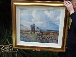 H Sloan holding framed painting