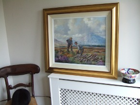 painting beside chair for scale