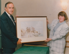 Taoiseach Albert Reynolds presented with a Hamilton Sloan painting by Carlingford Heritage Centre