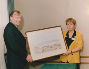 member of Albert Reynolds cabinet presented with Hamilton Sloan painting by Carlingford Heritage Centre