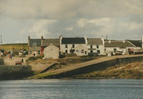 view of houses and harbour west town tory island