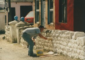 Tory islander whitewashing a wall on tory island