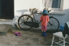 Hamilton Sloans niece catherine looking at a bicycle outside the cottage county Donegal